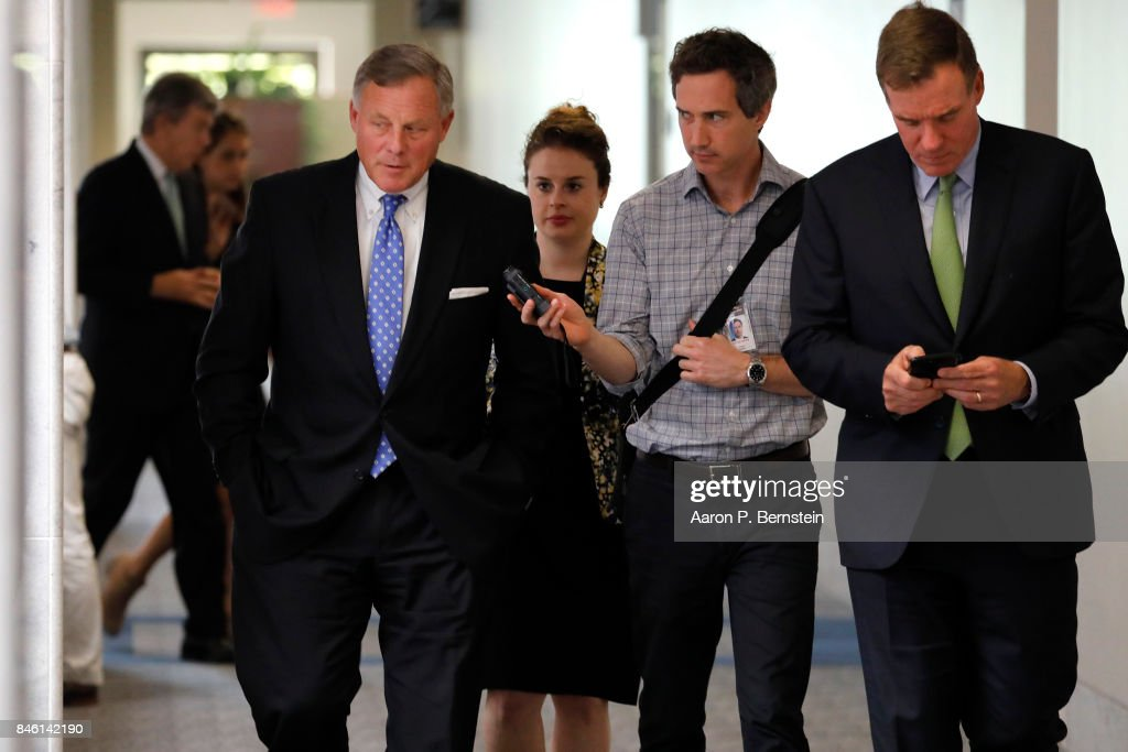 U.S. Sens. Richard Burr (R-NC) (L) and Mark Warner (D-VA) enter a meeting of the Senate Intelligence Committee on Capitol Hill September 7, 2017 in Washington, DC. The Committee is one of the bodies investigating Russian involvement in the 2016 election.
