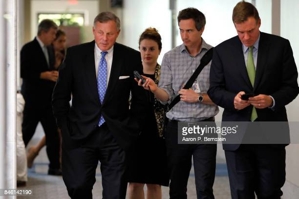 S Sens Richard Burr and Mark Warner enter a meeting of the Senate Intelligence Committee on Capitol Hill September 7 2017 in Washington DC The...
