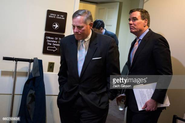 S Sens Richard Burr and Mark Warner head to a news conference to provide an update on the committee's investigation of Russian interference in the...