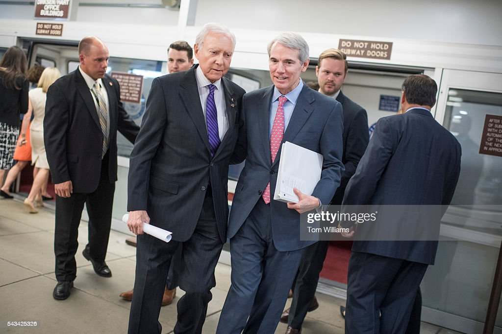 Sens. Rob Portman, R-Ohio, right, and Orrin Hatch, R-Utah, make their way through the Senate subway before a vote in the Capitol, June 28, 2016.