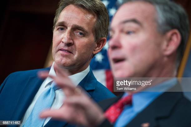 Sens Tim Kaine DVa right and Jeff Flake RAriz conduct a news conference in the Capitol to introduce an authorization for use of military force...