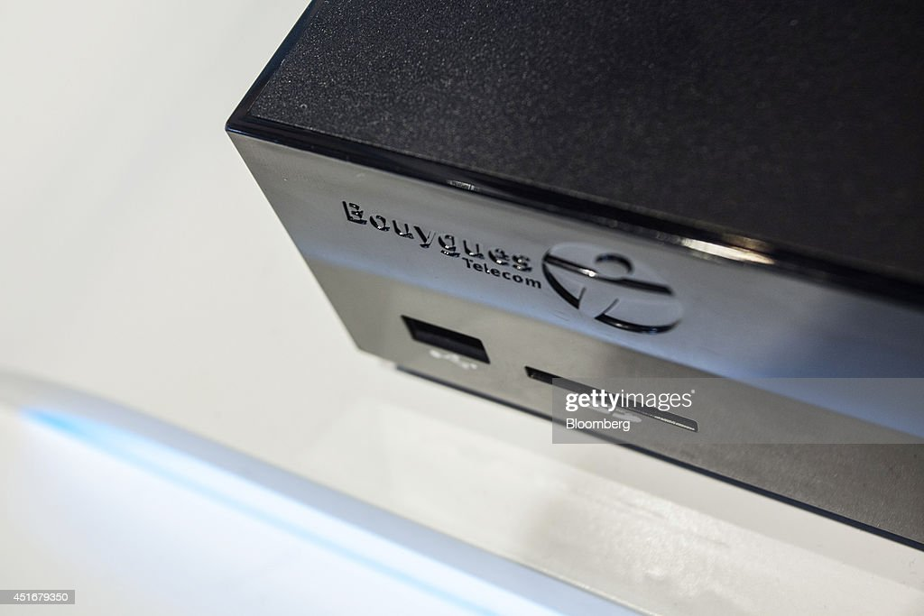 Sensation, a multimedia set top box from Bouygues Telecom, sits on display inside the company's mobile store, operated by Bouygues SA in Paris, France, on Thursday, July 3, 2014. Bouygues Telecom, France's third-largest mobile operator, was looking for a buyer as profitability and cash generation declined. Photographer: Balint Porneczi/Bloomberg via Getty Images
