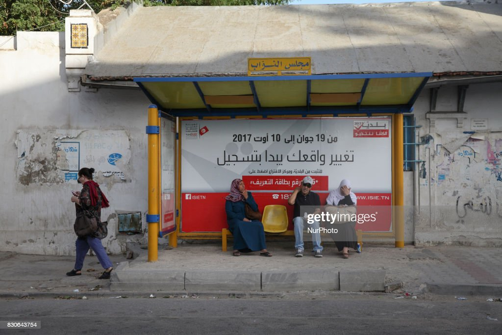 A sensitization poster for registration in the Tunisian municipal elections set for December 17, 2017, is seen in a bus stop located behind the building of the Assembly of the Representatives of the People (ARP) on August 11, 2017 in Bardo, Tunis, Tunisia.