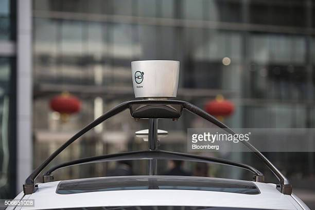 A sensor sits mounted on the roof of the Baidu Inc's autonomous car at the company's headquarters in Beijing China on Tuesday Jan 19 2016 Wang Jing...