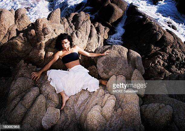JENIFER sensual attitude in black top and white skirt elongated on the rocks on the beach in CALA D'Orzu CORSICA