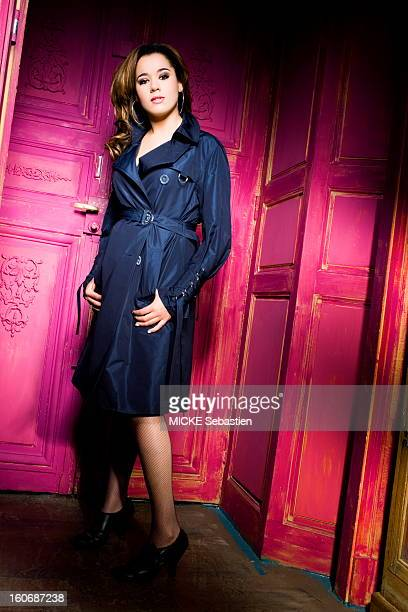 BADI sensual attitude of Chimene in waterproof fishnet stockings and shoes had high heels posing in front of a door painted pink