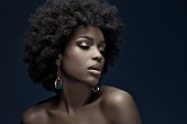 sensual black woman wearing luxury jewellery