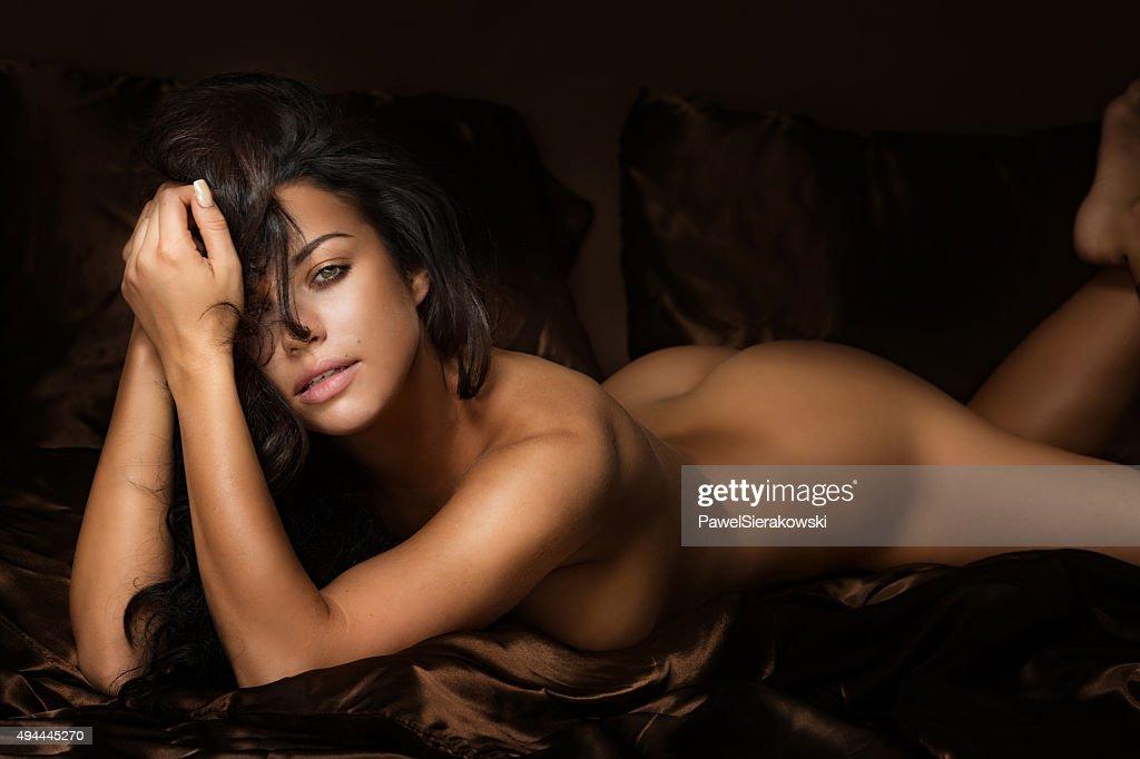 Women lying naked consider