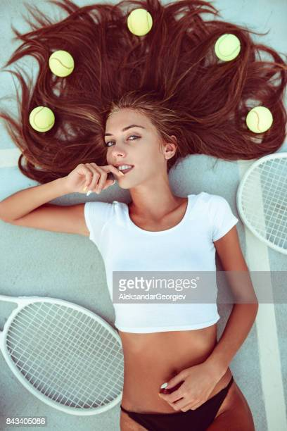 Sensual Female Lying on Tennis Court and Posing