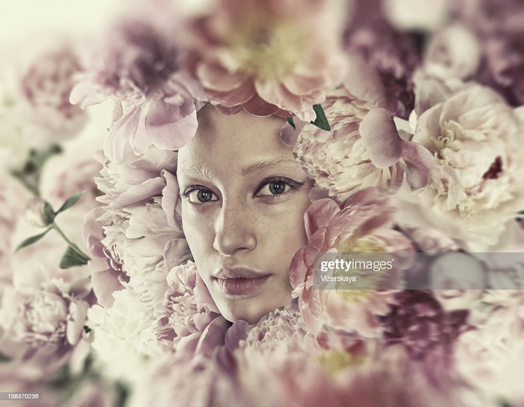 Sensual portrait in flowers : Stock Photo