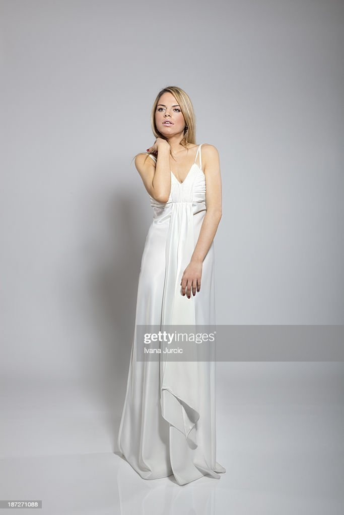Sensual portrait of young woman in dress