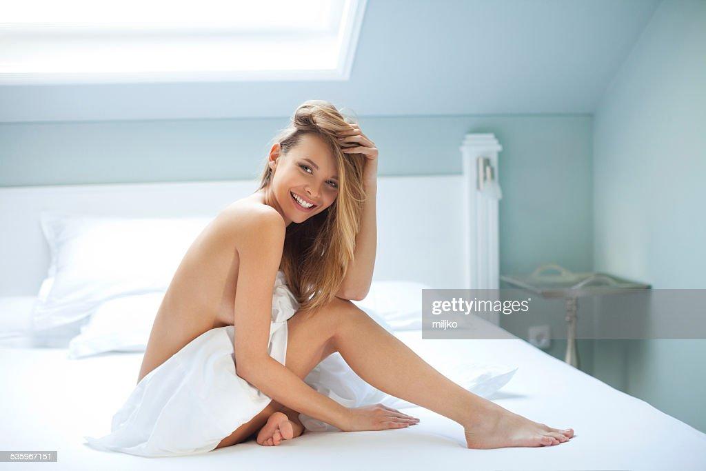 Sensual woman having fun in the bedroom : Stock Photo