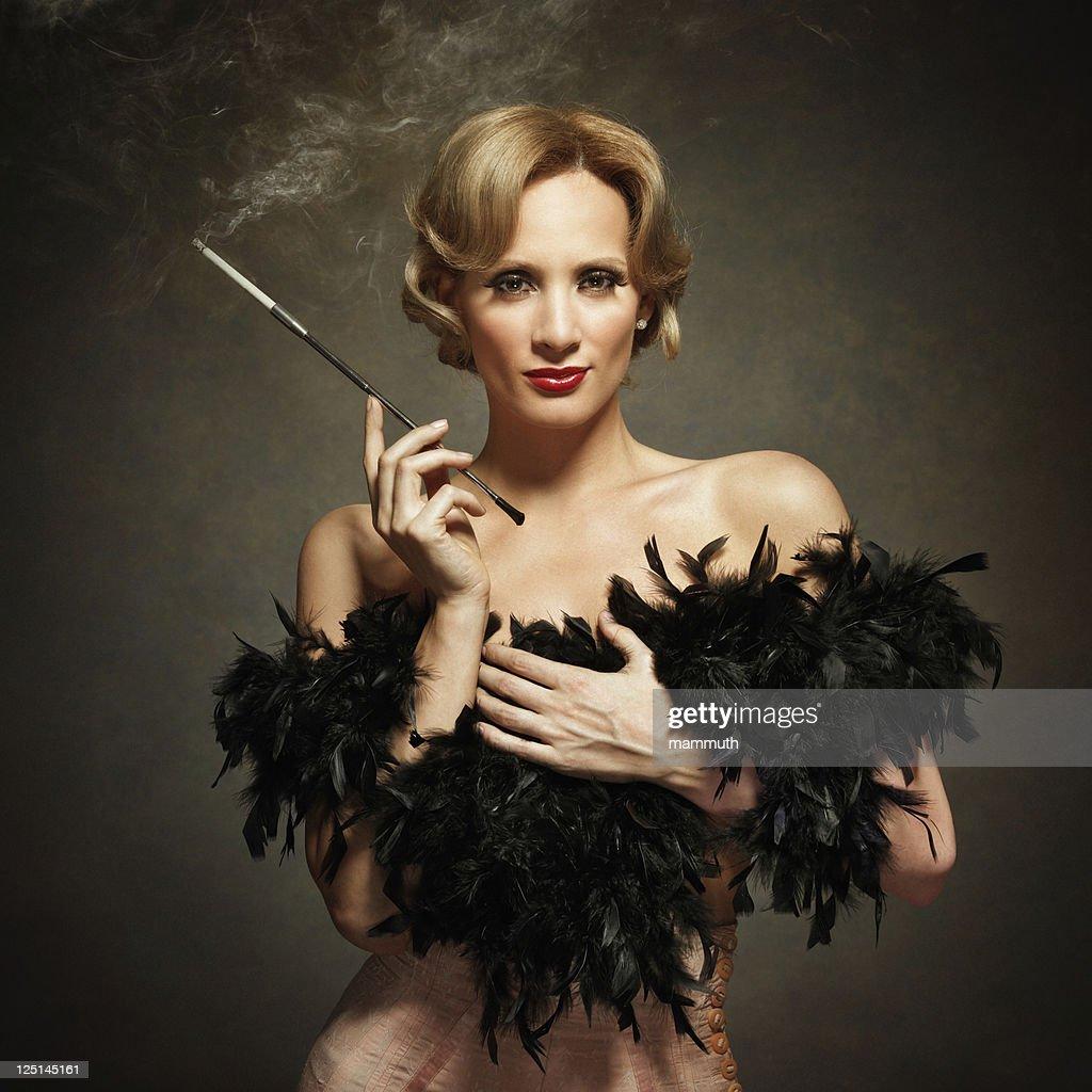 sensual woman smoking - vintage style : Stock Photo