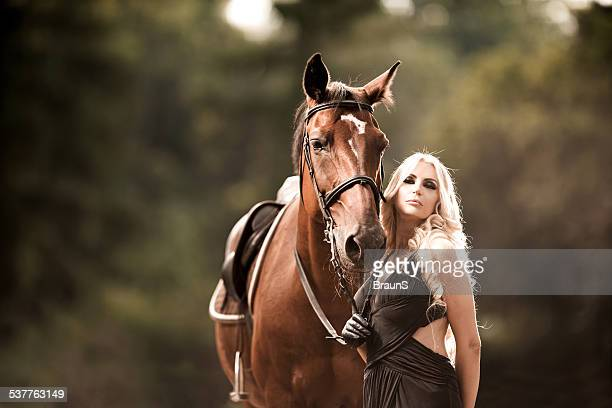 Sensual woman with a horse.