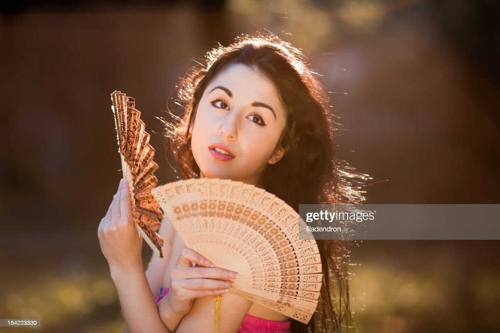 sensual woman with fan : Stock Photo