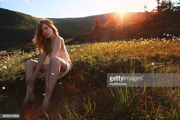 Sensual young woman in mountains.