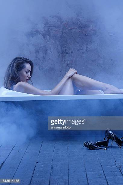 Sensual  young woman relaxing in bathtub   Bathroom Natural Beauty Portrait