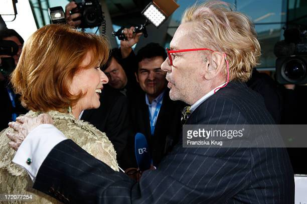 Senta Berger and Helmut Berger attend the Munich Film Festival 2013 Cine Merit Award 2013 at BMW World on July 01 2013 in Munich Germany