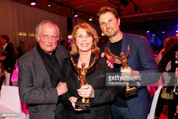 Senta Berger her husband Michael Verhoeven and her son Simon Verhoeven attend the Jupiter Award at Cafe Moskau on March 29 2017 in Berlin Germany
