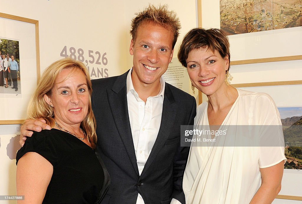 Sentebale CEO Cathy Ferrier, Chris Jackson and <a gi-track='captionPersonalityLinkClicked' href=/galleries/search?phrase=Kate+Silverton&family=editorial&specificpeople=666280 ng-click='$event.stopPropagation()'>Kate Silverton</a> attend the private view of 'Sentebale - Stories Of Hope', showcasing images by Getty Images' Royal photographer Chris Jackson of Sentebale's work helping the vulnerable children of Lesotho, at the Getty Images Gallery on July 25, 2013 in London, England.