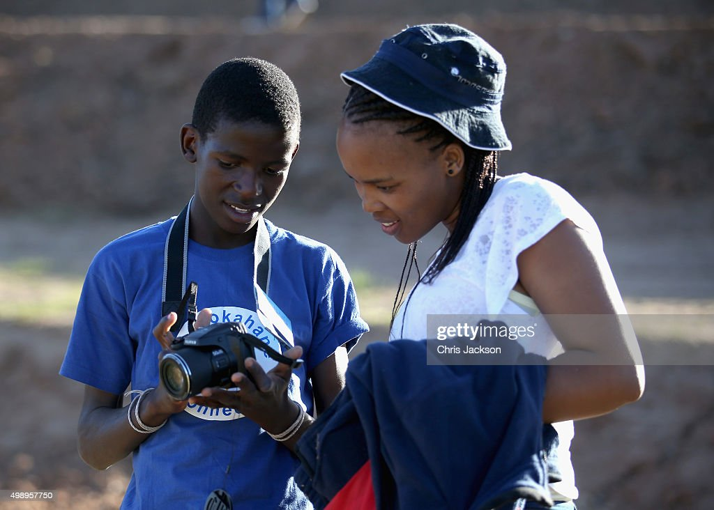 A Sentebale volunteer helps a young boy use a Fuji digital camera during a community camp at the Sentebale Mamohato Children's Centre on October 17, 2015 in Maseru, Lesotho. Getty Images have partnered with Prince Harry's Charity Sentebale to help bring photography to some of the vulnerable children of Lesotho. In an ongoing project and with the Support of Fujifilm Getty Images has helped develop and run lessons with children at the new Sentebale Mamohato Children's Centre as a way of helping develop interpersonal, creative and communication skills amongst some of the most disadvantaged children in the world. Sentebale was founded by Prince Harry and Prince Seeiso of Lesotho ten years ago.