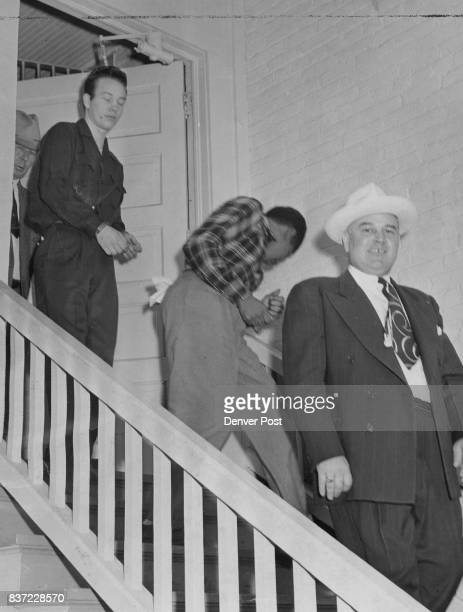 Sentenced to life imprisonment in the slaying of a Denver furniture dealer William Shearer is shown as he left county jail for the state penitentiary...