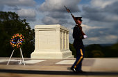 A sentinel strides by the Tomb of the Unknowns at Arlington National Cemetery on Sunday August 03 2014 in Arlington VA This year is the 100th...