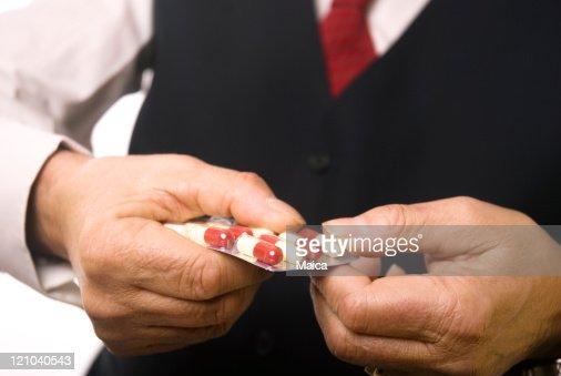 Senuior man taking medicine : Stock Photo