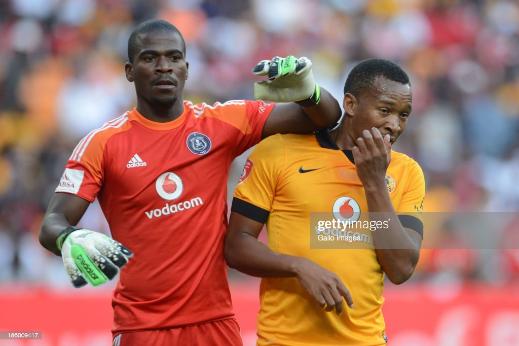 Senzo Meyiwa of Orlando Pirates and Lehlohonolo Majoro of Kaiser Chiefs during the Absa Premiership match between Orlando Pirates and Kaizer Chiefs at FNB Stadium on October 26, 2013 in Soweto, South Africa.