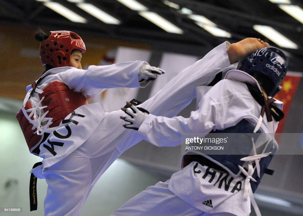 Seo Soyoung of South Korea fights with Shao Hua of China in the women's taekwondo under 67 kg final at the 2009 East Asian Games in Hong Kong on...
