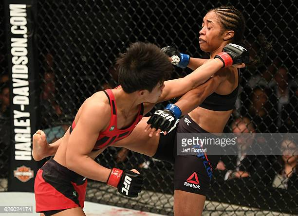 Seohee Ham of South Korea punches Danielle Taylor in their women's strawweight bout during the UFC Fight Night event at Rod Laver Arena on November...