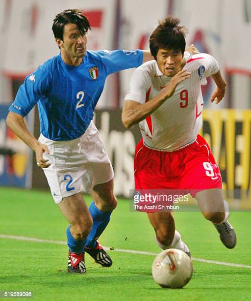 Seol KiHyeon of South Korea and Christian Panucci of Italy compete for the ball during the FIFA World Cup Korea/Japan round of 16 match between South...