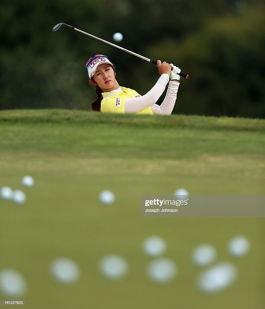 Seon Woo Bae from Korea hits balls from a bunker during her warm up for day three of the New Zealand Women's Golf Open at Clearwater Golf Course on February 10, 2013 in Christchurch, New Zealand.