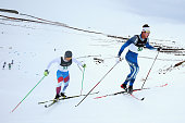SeongBeom Park of Korea and JunHo Hwang of Korea compete in the FIS CrossCountry Skiing ANC Mass Start Classic Mens race during the Winter Games NZ...