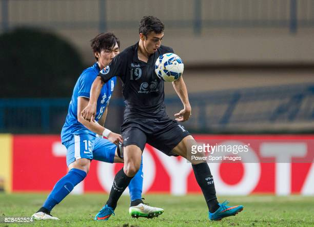 Seongnam FC forward Lucas Pajeu De Sousa fights for the ball with Guangzhou RF defender Jang Hyunsoo during the AFC Champions League 2015 Group Stage...