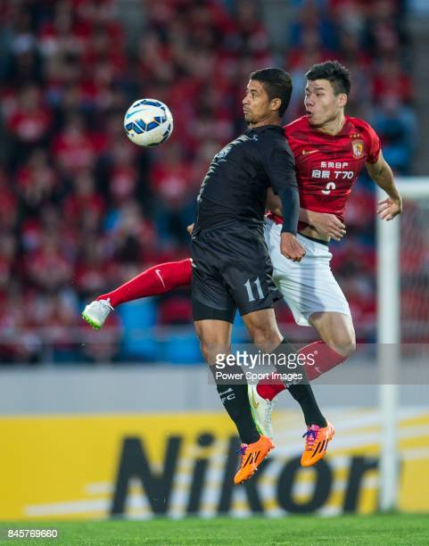 Seongnam FC forward Ricardo Bueno Da Silva fights for the ball with Guangzhou Evergrande defender Feng Xiaoting during the 2015 AFC Champions League...