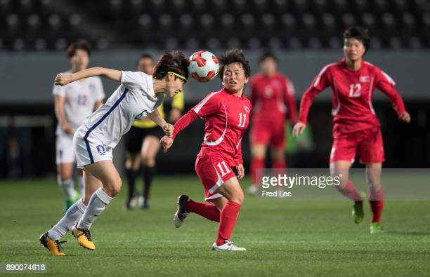 Seonjoo of South Korea and Sung Hyang Sim of DPR Korea in action during the EAFF E1 Women's Football Championship between North Korea and South Korea...
