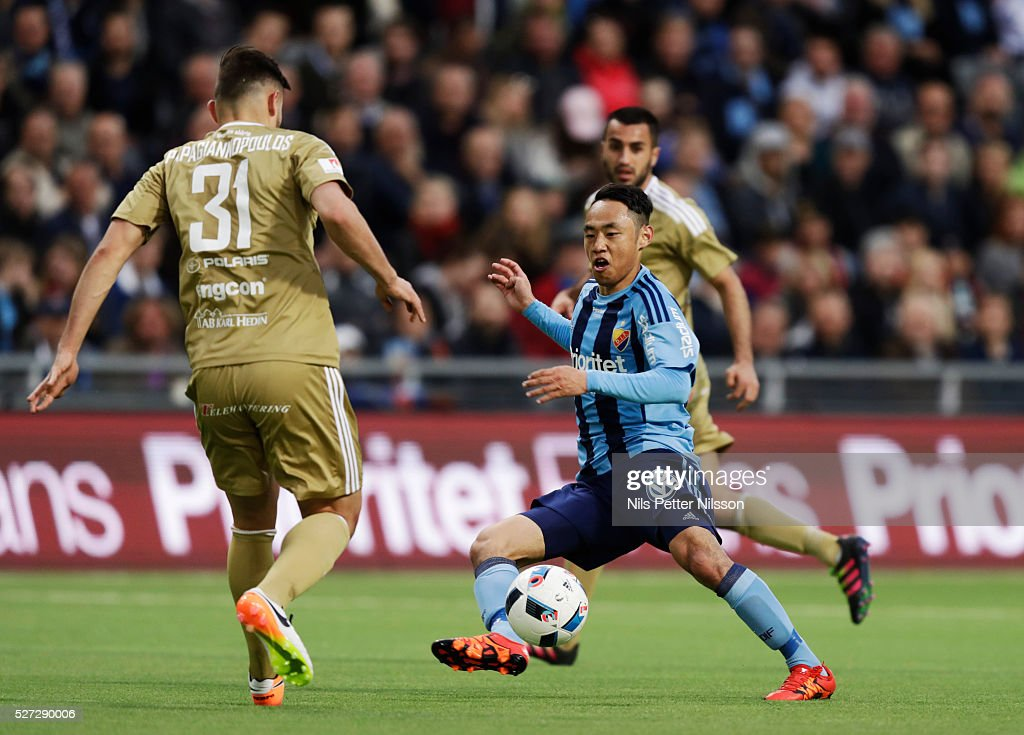Seon-Min Moon of Djurgardens IF and Stotirios Papagiannopoulus of Ostersunds FK competes for the ball during the Allsvenskan match between Djurgardens IF and Ostersunds FK at Tele2 Arena on May 2, 2016 in Stockholm, Sweden.