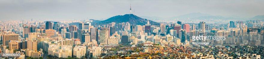Seoul crowded skyscraper cityscape downtown Namsan Tower sunset panorama Korea