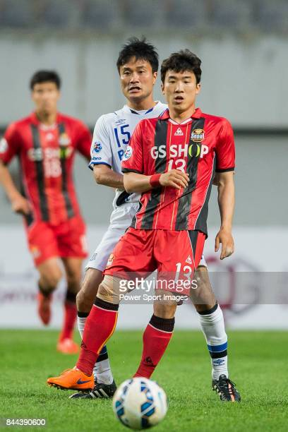 Seoul forward Go Yohan fights for the ball with Gamba Osaka defender Konno Yasuyuki during the 2015 AFC Champions League Round of 16 1st Leg match...