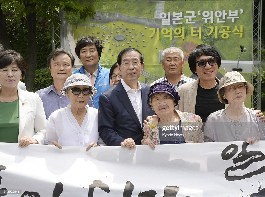 Seoul Mayor Park Won Soon (C in front) and former 'comfort women' attend a groundbreaking ceremony in Seoul on June 29, 2016, to create a Site of Remembrance for those forced into the Japanese military's wartime brothels. The memorial site at the former residence of the Japanese colonial governor generals at Namsan Mountain in central Seoul will be completed by Aug. 15.