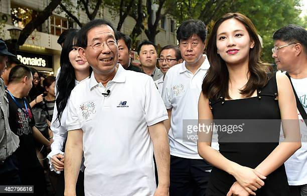 Seoul Mayor Park Wonsoon and South Korean girl group miss A promote Seoul tourism on August 2 2015 in Guangzhou China
