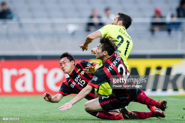 Seoul Midfielder Kim Won Sik trips up with Urawa Reds Forward Zlatan Ljubijankic during the AFC Champions League 2017 Group F match between FC Seoul...