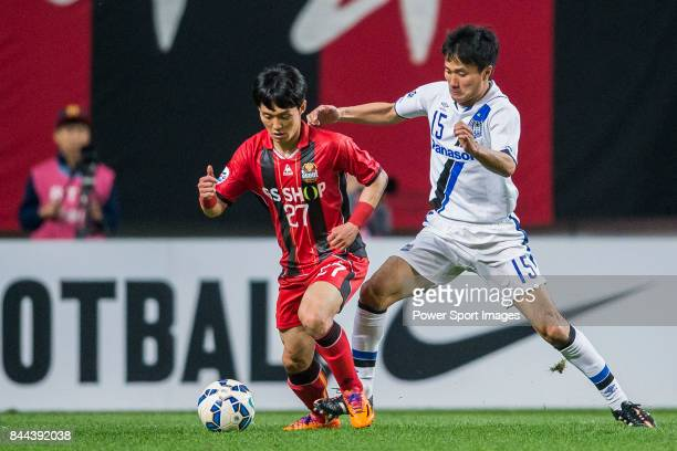 Seoul Midfielder Ko Kwang Min fights for the ball with Gamba Osaka defender Konno Yasuyuki during the 2015 AFC Champions League Round of 16 1st Leg...