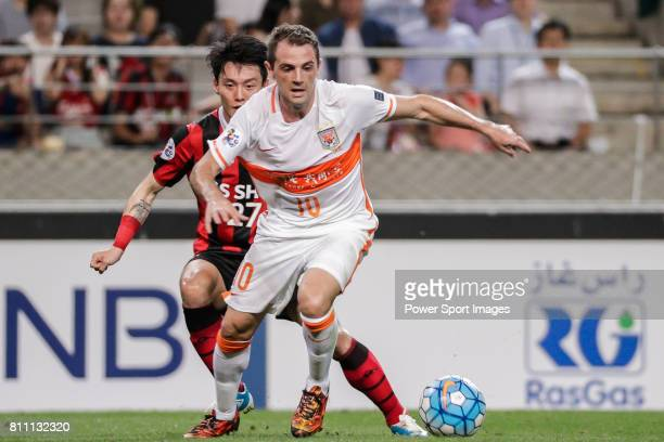 Seoul midfielder Ko Kwang Min fights for the ball with Shandong Luneng FC midfielder Walter Montillo during the AFC Champions League 2016 Quarter...