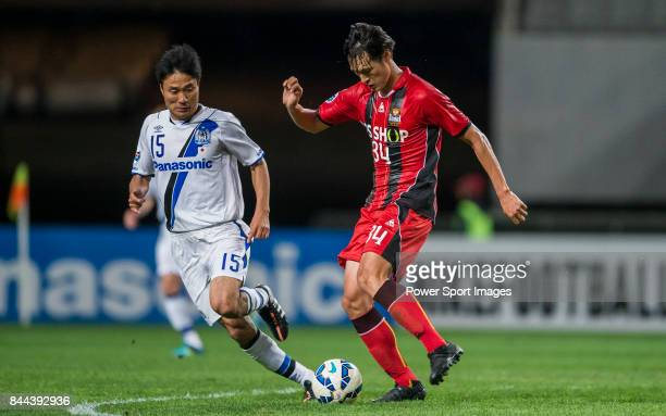 Seoul Midfielder Park Yongwoo fights for the ball with Gamba Osaka defender Konno Yasuyuki during the 2015 AFC Champions League Round of 16 1st Leg...