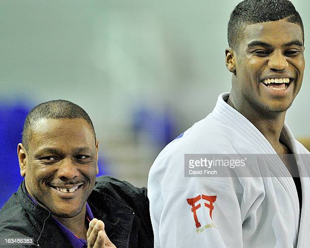 Seoul Olympic bronze medallist Dennis Stewart jokingly shows his support for Philip AwitiAlcaraz just before the final when three time Olympian...