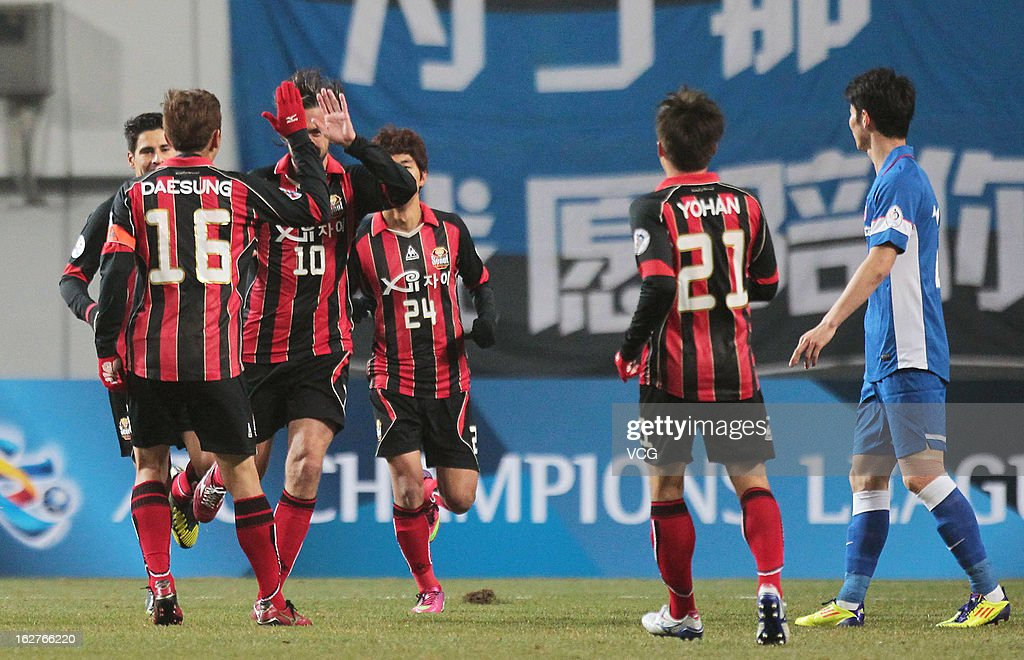 FC Seoul players celebrate a goal during the AFC Champions League match between FC Seoul and Jiangsu Sainty at Seoul World Cup Stadium on February 26, 2013 in Seoul, South Korea.
