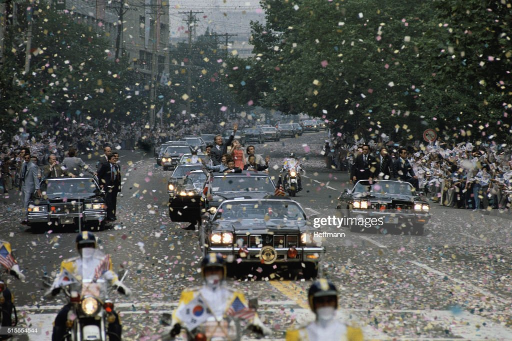 President Carter his wife Rosalynn and daughter Amy ride with President Park Chung Hee of South Korea in a motorcade