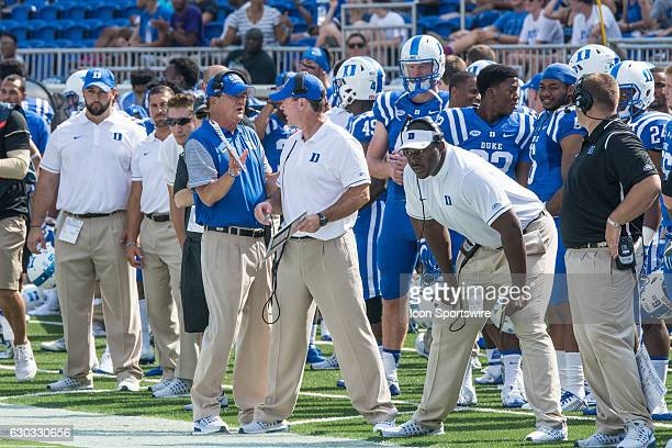 Duke Blue Devils head coach David Cutcliffe talks to his coaching staff on the sideline NCAA College Football Wake Forest at Duke Wallace Wade...